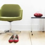 Chair and Slippers in Modern Living Room --- Image by © Royalty-Free/Corbis