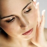 Woman with Hand on Face --- Image by © Royalty-Free/Corbis